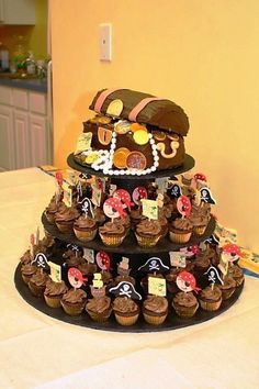 Pirate Minis And Treasure Chest Chocolate cake and mini cupcakes filled with chocolate ganache and topped with chocolate buttercream.How to Host a Pirate-Themed First Birthday PartyShiver me timbers, your baby is turning one! Pirate Birthday Cake, Pirate Cupcake, Pirate Birthday Parties, Free Birthday, Themed Parties, 5th Birthday, Treasure Chest Cake, Pirate Treasure Chest, Cake Central