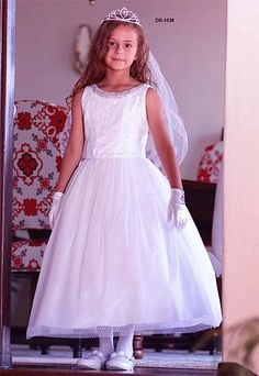 Elegant floor length communion dress made of mesh & tulle with rhinestones on the bodice is made in the USA.