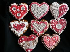 folkloric hearts for Valentine's ... heart shaped ... red & white royal icing ... delicate white piping ...