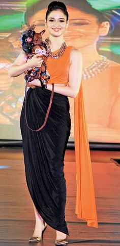 Tamannaah Bhatia with a fancily clad Chihuahua while promoting her film 'Entertainment' in Bangalore in a unique fashion. Indian Attire, Indian Wear, Indian Designer Outfits, Designer Dresses, Indian Dresses, Indian Outfits, Look Short, Indian Fashion, Unique Fashion