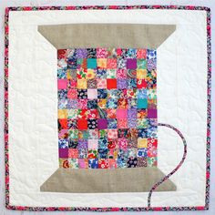 Liberty Vintage Cotton Reel Mini Quilt PDF. By Jemima Flendt, Tied with a Ribbon