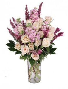 The Exquisite Arrangement! Let them know they make a difference with our Exquisite Arrangement, featuring lavender stock, ivory spray roses and accents of fuchsia heather. Because they're the glue that holds the office together, recognize your hardworking staff with Administrative Professionals Day flowers.