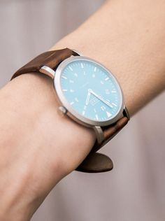 The deep brown band is so rustic! Also love the Blue dial <3 <3
