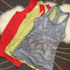 Trio of Nike Tanks Fun mix of colors and prints - 3 Nike tanks ready for a new loving home. All size medium. These just don't fit me anymore. Great to mix and match with your workout wear or with everyday wear. ❤️no trades. Nike Tops Tank Tops
