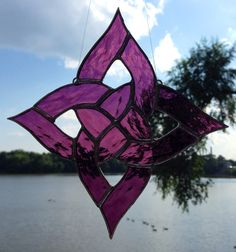 This pattern was drawn by my husband and is an exclusive to Sweveneers. It is not to be reproduced by other stained glass artist. Copyright 2013.  Dark Purple Square Celtic Knot Sun Catcher on Etsy, $30.00