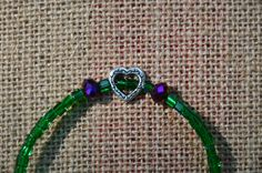 emerald green anklet with purple and by LightningBugBoutique