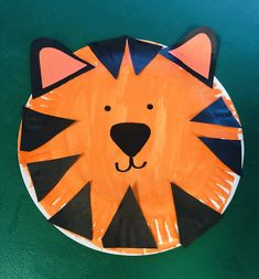 Kids paint paper plate. Then they glue triangles to make a mask.