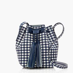 """Our newest bucket bag is crafted in an embossed textured leather featuring gingham, one of our favorite prints of the season. It also features a tassel drawstring closure and handy interior pocket (so you don't have to dig for your ID/lipstick/phone). <ul><li>8""""H x 5 3/4""""W x 5 1/4""""D.</li><li>24"""" adjustable strap.</li><li>Leather.</li><li>Import.</li></ul>"""