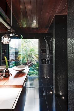 Take it outside: Create the sensation of showering outdoors with a floor-to-ceiling window - if the position is right! Add an overhead…
