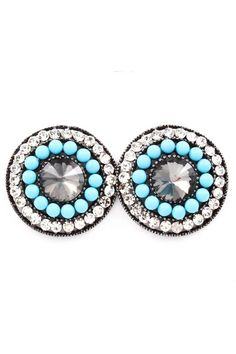 Stud earrings with crystals, blue beads, and a big crystal in the middle