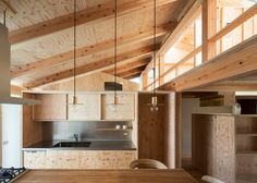 A wooden structure and hand-built joinery are left exposed throughout the interior of this compact house in Japan by architecture studio Hitotomori