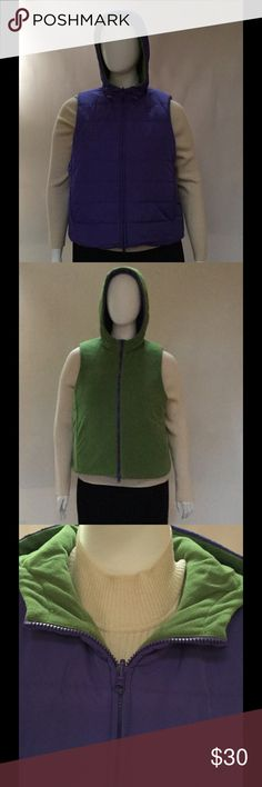 "Jones New York Reversible Vest Jones New York Sport creates a chic look for day or night with its reversible, women's vest. The first side is quilted purple and the second side is green, with a fleece-like material. Hooded. Zip-front closure. Front welt pockets. Hits at hips. Lightweight. Drawstring in hood.  Approx. 24"" long; approx. 48"" bust. Sleeveless. Size Women's XL.  Cleaned and ready to wear. Imported. Jones New York Jackets & Coats Vests"