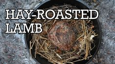James Gop shows how to cook a leg of lamb, over the fire in hay.