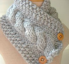 Hand knitted soft and comfy cowl style scarf shown in beautiful soft Heather Grey colorway. Two button closure and cable design make this cowl functional and stylish. Hand knitted in a soft wool blend. $30 #knitting #fashion #grey #silver #scarf #cowl #handmade #etsy #wool