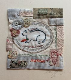A hand stitched patchwork piece with the centre being a French bunny eating is carrot withing a magic garden the patched border contains a hand stitched sacred heart and flowers made from rag scrapsEmbroidery Measures: 15cm/15cmThis items is mounted on a rough natural board measuring: 25/25cmThis items will come wrapped and posted recorded delivery please note this is a one of item that is why it will be posted requiring a signature on delivery to your addressTO VIEW...