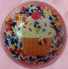 Circle Cupcake Resin Charm with Sprinkles. $4.00, via Etsy.