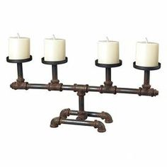 "Industrial-inspired candleholder with a pipes silhouette.      Product: Candleholder    Construction Material: Metal   Color: Rust Features: Pipe silhouettes    Accommodates: (4) Candles - not included Dimensions: 9.5"" H x 21"" W x 5"" D"