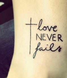 love never fails. 1 corinthians 1:8 wrist tattoo