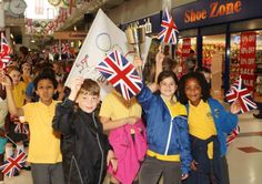 Pupils at Weston Favell Primary School make their own version of the Olympic Torch. The pupils walked through nearby Weston Favell Shopping Centre proudly displaying the torch they had made in school.