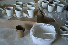 Tutorial: Peat pots dipped in the plaster to make  neat looking containers. The creator of these made Halloween containers But one could make other designs like a snowman for Christmas.