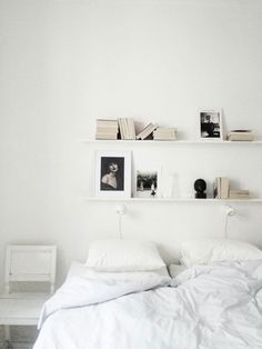 White bedroom + shelving.