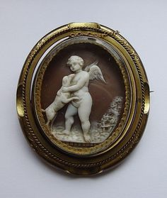 ANTIQUE VICTORIAN SHELL CAMEO BROOCH: CUPID (EROS) PLAYING WITH A DOG