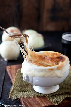 Stout French Onion Soup 6 tbs butter 2 lb sweet white onion, sliced into ¼ inch rings 1 tbs brown sugar ½ tsp salt 2 cups stout, divided 2 cups beef stock ½ tsp fresh cracker black pepper 4 slices French bread, toasted 8 ounces shredded or sliced Gruyère cheese (about 2 1/2 cups)