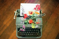typewriter with flowers