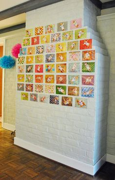 weekly photos on display for first birthday party. -- saw this on young house love, and will def. be doing this with my kids. best. idea. EVER!!!!!