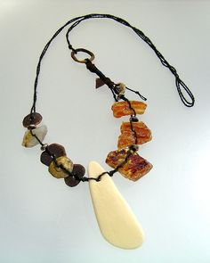 amber and shell goddess; bronze, amber and rutilated quartz nuggets, shell fragment on hand-plied linen cord ... kathy van kleeck