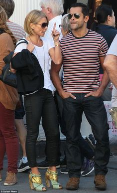 Stars and stripes: Actor Consuelos wore a casual shirt of black, red and white