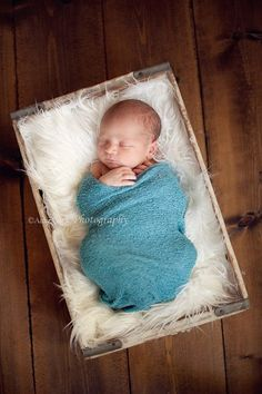 boy and fur- and I bet I could dye cheesecloth for a similar swaddle