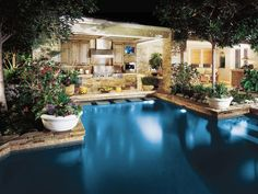 Outdoor Kitchen with Poolside Escape | HGTVRemodels.com