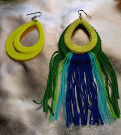 Turn your yellow plastic earrings into peacock style