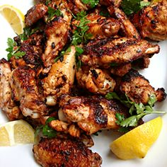 Grilled wings marinated in preserved lemon, garlic, hot Spainish paprika, and olive oil