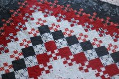 Blooming nine patch quilt by maura