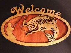 A dual layer of stained wood was used to create this scroll work welcome sign. The background was stained Cherry and the Foreground was stained Oak. The piece is then finished in a coat of shellac.