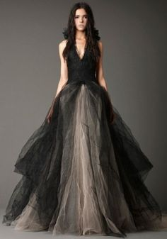 V-neck halter ball gown with Chantilly lace bodice and distressed organza and shadow lace flowers at neck and multi-layered crinkle tulle skirt, Available in solid ivory, shown in black.