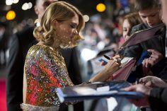 Léa Seydoux signs autographs for fans at the #SPECTRE World Premiere.