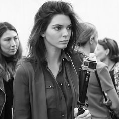 Kendall Jenner prepares backstage before the Elie Saab show during...