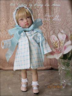 Nancy Lee Moran repainted this doll face, Kish Tatum by Helen Kish.  Tatum wears a blue coat by Chris Miller, photo copyrighted by Nancy Lee Moran 2013  #repaint #doll  #Kish