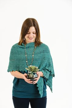 Easy single and double crochet combine to make a light and lacy shawl that brings to mind the promise of a spring garden.