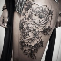 The peony flower is said to symbolize compassion and prosperity. #InkedMagazine #thigh #flower #tattoo #tattoos #art