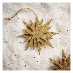 West Elm Glitter Kraft Layered Star Ornament ($4) ❤ liked on Polyvore featuring home, home decor, holiday decorations, gold, glitter star ornaments, glitter ornaments, star ornaments, star home decor and west elm