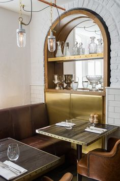 Amazing tables from Apero Restaurant in London. The brass hardware is exceptional and the wood has a reclaimed and #rustic look to it