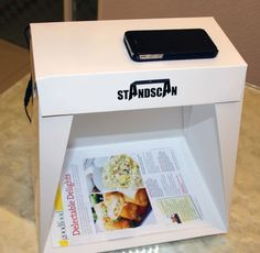 StandScan is a portable iPhone/smartphone scanning stand that looks an awful lot like Scanbox and has the same pluses and minuses. It folds down flat, and the Pro model includes built-in LED lighting to ensure adequate lighting on your document. The main disadvantages are that the height is not adjustable (for scanning large sheets) and it seems difficult or impossible to place a large bound book in the scanning area. Nevertheless, it would be great if they developed an iPad-compatible version.