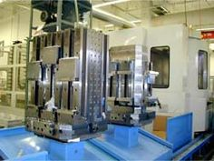 "Kurt Product: Kurt Vise/Tombstone Machine: 630mm HMC Customer: Machine Equipment Manufacturer Comment: 9 pallet FMS, all Kurt Workholding, 8XLPT vises on two faces, 2"" x 2"" grid on two faces for Kurt ML35. - http://www.kurtworkholding.com/custom/hmc.php"