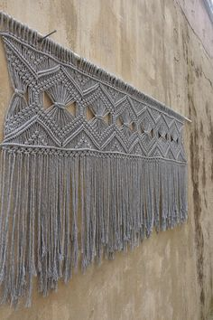 Large Gray Macrame wall hanging / macrame headboard. Geometrical wall art. Width- 150 cm Knotted part from the dowel: 37 cm Length from the stick- 80 cm Please NOTE, this item is not coming with a dowel/stick. This Wall hanging has also a matching runner. Please check it