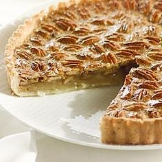 Wolfgang Puck Pecan Pie. This is an American classic, but one that requires special attention to avoid cloying sweetness or a soggy crust. I like to toast the pecans before combining them with the other ingredients. And a moderate oven works better than a hot one.