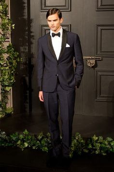 It doesn't get more classic than this example. This man looks incredible. Do I sense a Navy/Black wedding trend on the horizon?